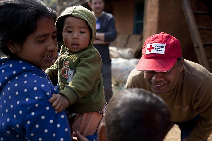 Eine nepalesiche Mutter mit Baby