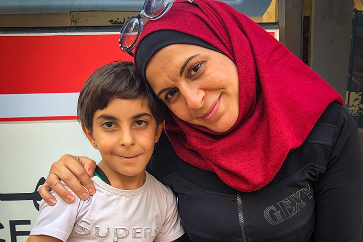 Syrian mother and son at mobile clinic